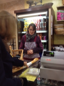 Alison buying a baguette