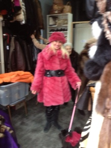 At the flea market in bubble gum pink fur and a matching dog.