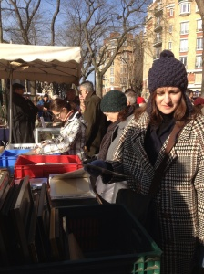 Joan looking at bric a brac at the Vanves flea market.