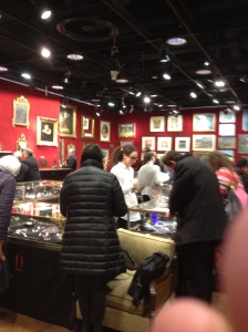 Drouot inside one of the many rooms full of auction items (and part of my thumb in the photo).