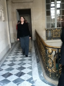 Laura, who had the good sense to dress to look good on Carrera marble floors in Versailles.