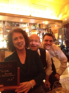 "Joan with her ""tortiflette"" special and two happy waiters."