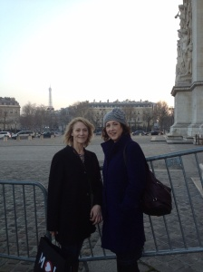 At the Arc de Triomphe with the Eiffel Tower in the background.