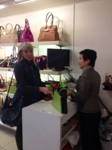 Barb buying a purse at Maroquinerie St Honore at 334 rue St Honore in the 1st arrondissement.