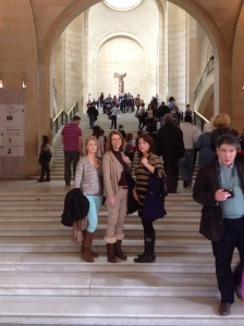 At the Louvre on the steps leading to the Winged Victory statue.
