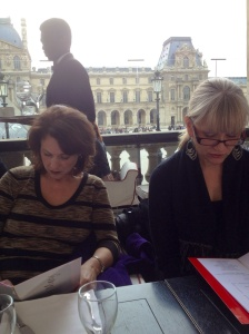 Joan and Barb at Marly restaurant with the Louvre behind them.