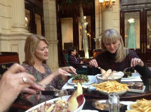 Marsha and Barb with all our food at Cafe de la Paix. I failed to get a picture of the to-die-for hot chocolate.