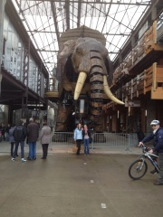 The elephant is powered by man and machine and you can ride him. It was amazing. It was made in Mantes in a former ship making building.