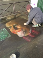 "Street artist, Paris. He wrote, ""Life without art is stupid."""